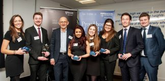 WInners of the Greggs Challenge 2016, dressed in smart suits, posing with their trophies