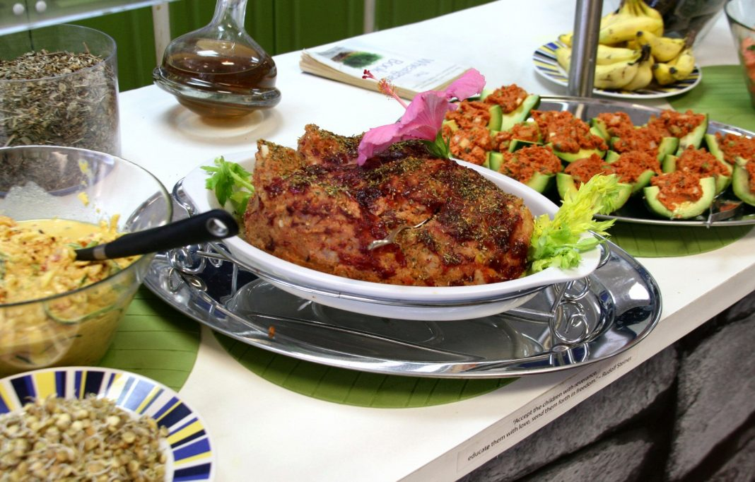 Several vegan dishes displayed on a table